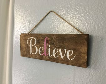 Rustic Hanging Wood Sign that says, Believe in Stenciled White Paint with a Pink Cancer Ribbon