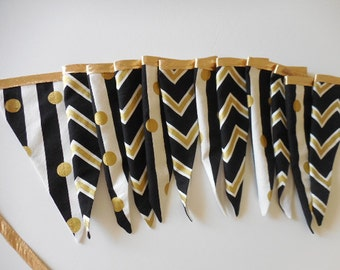 Modern flag bunting banner in black white and gold stripe and chevron