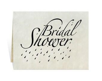 Bridal shower card art for wedding engagement party celebration invitations with elegant lettering, showering raindrops, kit you print black