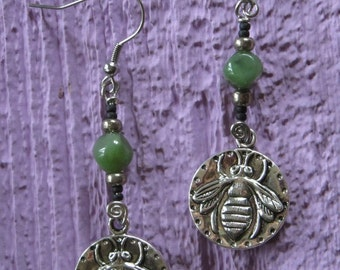Earrings made whit recycled beads and metal pendant with a printed bee