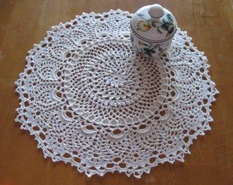 New cream hand-crocheted doily