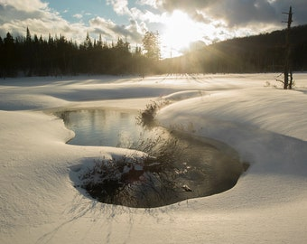 Rays of light and snowstorm in winter on Lac-à-René, Chaudière-Appalaches