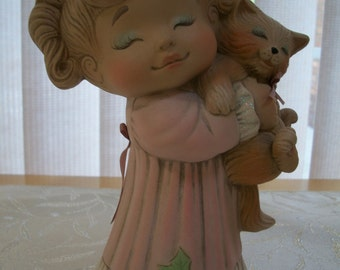 ceramic girl tot Christmas morning figurine holding kitty