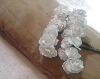 24 white paper flowers wired