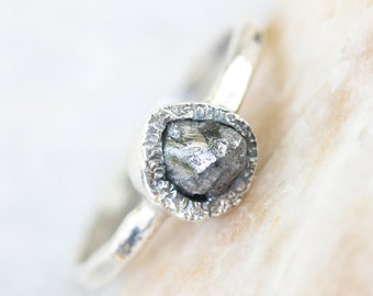 Pear shape Rough diamond ring in silver bezel setting with sterling silver hammer textured oxidized band
