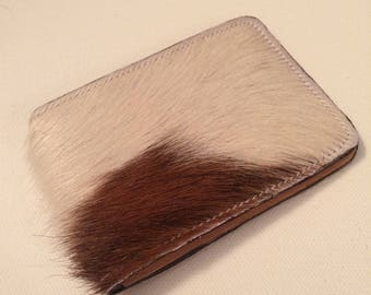 White and brown fluffy genuine leather cardholder. Protecting inlayer
