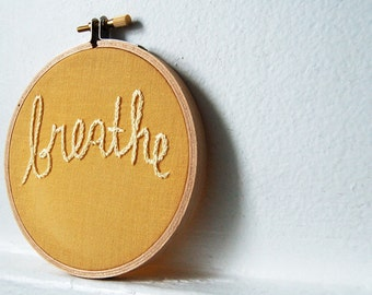 Breathe. Hand Embroidery in 4 inch Hoop. Yellow. Miniature Fiber Art Sign. Handmade by merriweathercouncil on Etsy