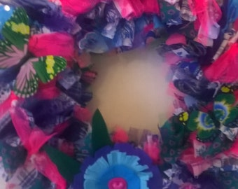 Rainbow fabric wreath with butterflies and a felt flower