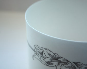 White candle holder. Fine white bone china stoneware vessel or tealight holder with a black motif.