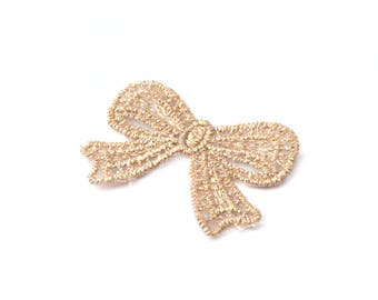 Applied bow 5 x 3 cm in cotton yarn and natural color gold