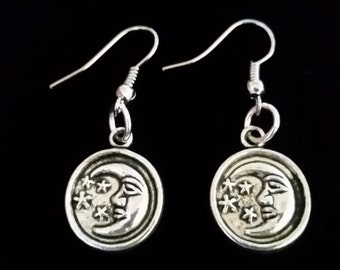 Beautiful silver colored pewter celestial moon and star charm dangle hook earrings