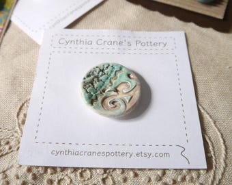 Large Round Clay Button, Textured Detail, Glazed in Soft Aqua and Brown