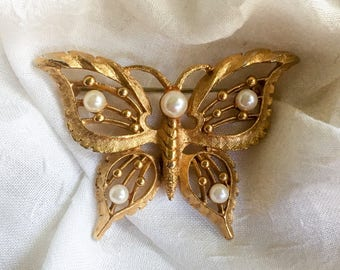 Vintage gold tone & feaux pearl Butterfly pin from the 1960's
