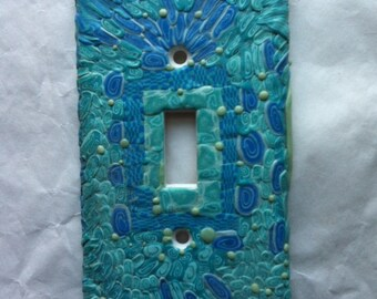 Blues, aquas and glow in the dark polymer clay caned switchlate cover. Housewarming gift with free shipping.