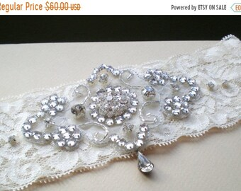ON SALE Silver Bridal Garter SET.. Romantic Silver Gems on Wide Ivory Lace. French Bridal Garters. Sower Gift. Rhinestone Drop. Wide Ivory L