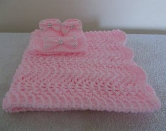 Hand knitted babies pink crib/pram blanket with booties and headband