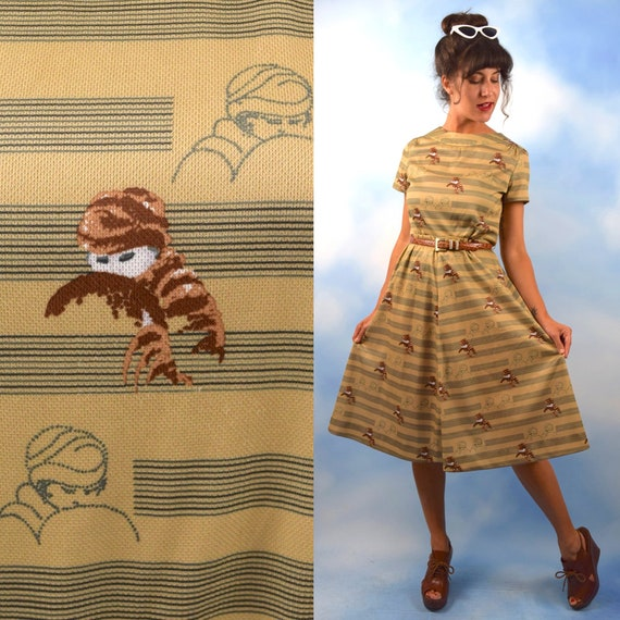 Vintage 70s does 50s Mysterious Ladies Novelty Print Shirt Waist Dress (size medium, large)