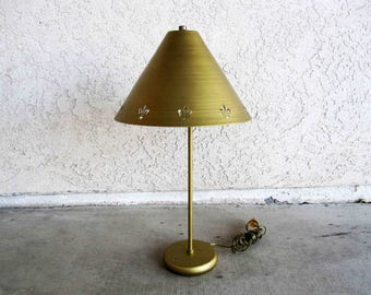 Vintage Mid Century Brass Finish Lamp with Fleur-de-lis Shade. Circa 1960's.