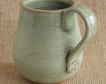 handmade ceramic mug in glossy sage green