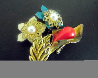 Vintage gold-tone brooch with what appear to be enameled flowers with pearl centers. vintage brooch, vintage jewelry