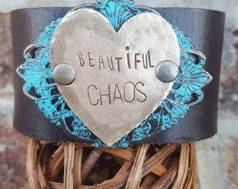 """Brown Leather Cuff  with the words """"Beautiful CHAOS"""" on hammered Brass Heart Metal-Quote"""