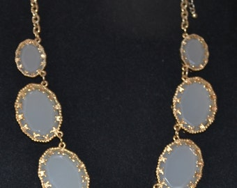 NECKLACE made up of 7 Stunning BEVELED MILKY Glass Oval piece, each enclosed in Gold Tone Mounting. Approx. 10 inches long,