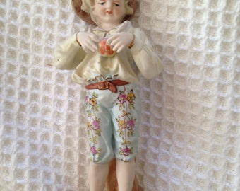 Old world looking bisque boy and girl figurines