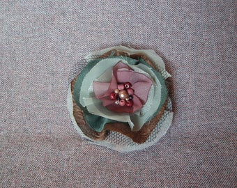 Green and purple brooch
