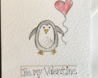 Hand drawn illustrated penguin valentines card