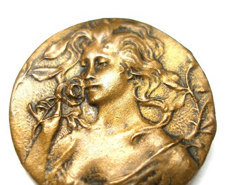 "Antique Art Nouveau BUTTON, French brass with lovely woman holding a rose, 3/4""."