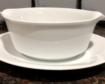Gravy or Sauce Boat in white porcelain with attached saucer