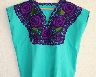 Typical mexican blouse (green with purple embroidery)