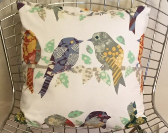 Small birds on a branch pillow