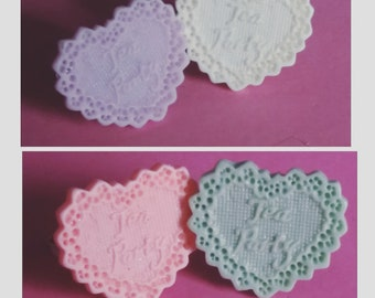 Kawaii/cute heart shaped pastel tea party lolita ring| pink resin with white letters and bow