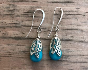 Turquoise magnesite teardrops with silver leaf bead caps