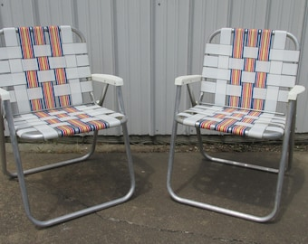 Vintage Pair Aluminum Webbed Lawn Chairs Yellow, Orange Red Blue And White