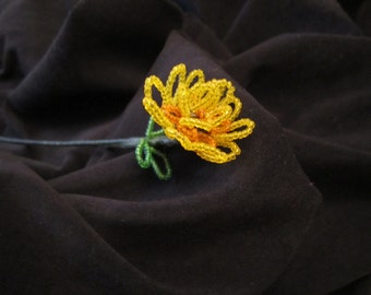 French beaded yellow and orange flower on stem