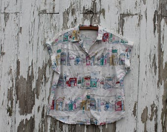 1980s blouse, white with pen and watercolor style buildings, button up, collared, short sleeve shirt, medium, cotton or blend, cuffed