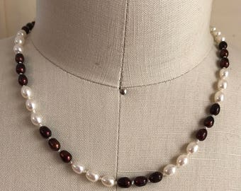 Port and cream knotted pearls on silk
