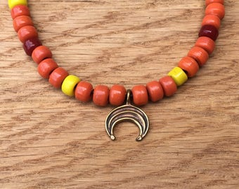 Luna on Fire! Bronze Lunula amulet with antique glass trade beads