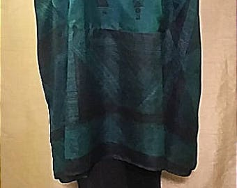 One-of-a-kind 100% up-cycled silk beautiful emeral green ethnic themed tunic featuring over-sized cowl neck and front pocket detail