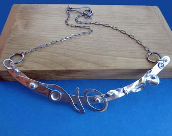Abstract Arc Sterling Silver Bib Style Artwear Necklace by Judi Goldblatt Studio