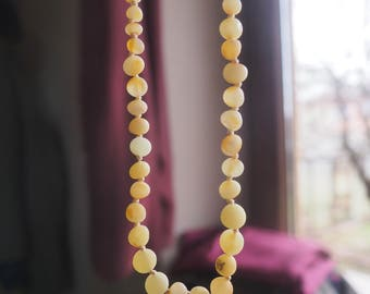 RAW Baltic Amber Teething Necklace raw lemon matt baroque shape