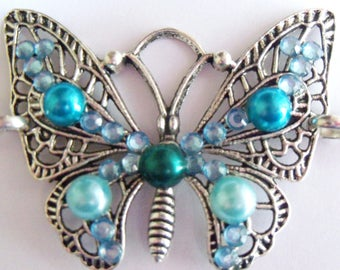 Cute blue butterfly bracelet, silver chain and beads in turquoise