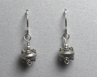 Sterling silver earrings with small Bali disk bead