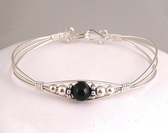 Black Onyx and sterling silver wire wrap bracelet