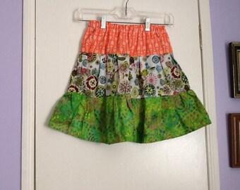 Handmade girls tiered skirt size 10, multi colors of orange,blue prints