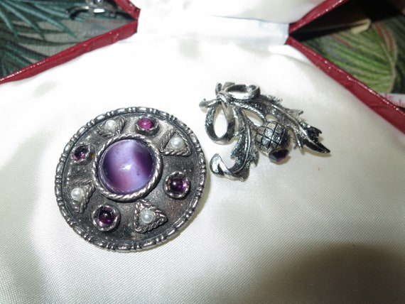 2 lovely vintage Scottish silvertone amethyst glass thistle brooches or pendant