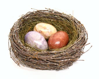 Set of Three Polished Stone Eggs in Hues of Pink & Purple in Decorative Nest Shaped Woven Twig and Grass Basket
