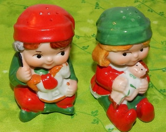 Vintage Pair of Salt and Pepper Shakers Porcelain Boy and Girl with Christmas Toys , Red,Green and White Avon